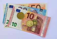 Bank Notes And Change Euros. A Fifty twenty and ten euro note plus some cents in change Stock Photography