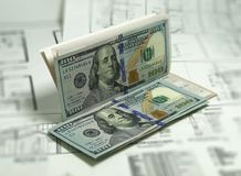 Bank Notes 100 Dollar Bills Check over Plans. Photo Image Royalty Free Stock Photo