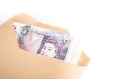 Bank notes in envelope. British pound bank notes in envelope Stock Image