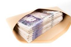 Bank notes in envelope. British pound bank notes in envelope Stock Images