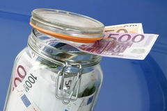 Bank notes in a glass jar Stock Image