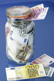 Bank notes in a glass jar Royalty Free Stock Photo