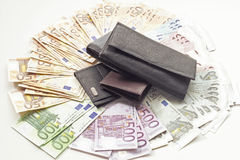 Bank notes and wallet Stock Images