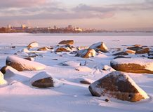 Winter Bank of the Ob river and Novosibirsk on the horizon stock photography