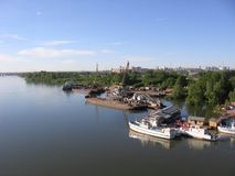 The Bank of the Ob river in Novosibirsk ships moored to the pier in the summer stock photo