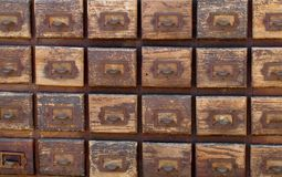 Bank of old wooden file card drawers Royalty Free Stock Image