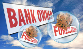Bank Owned Foreclosure. Illustrated signs of house bank owned house foreclosure. Blue sky and cloud background Royalty Free Stock Image