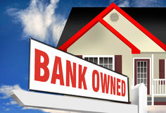 Bank owned property. Illustration of foreclosure by placing a ' bank owned ' sign in large red upper case letters in front of a modern home with blue sky Stock Photos
