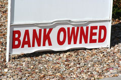 Bank owned property sign. Property for sale with bank owned sign stock photography