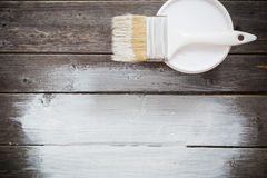 Bank paints and brush on  wooden background Royalty Free Stock Photo