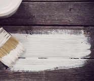 Bank paints and brush on  wooden background Royalty Free Stock Images
