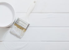Bank paints and brush on a  wooden background Royalty Free Stock Photography