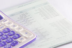 Bank passbook with  part of calculator Stock Images