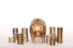 bank piggy mynt Arkivfoton