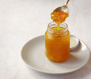 Bank with quince jam on the table Royalty Free Stock Photo