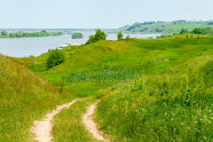Bank of the river Oka. Field road in the green hills to the river bank Royalty Free Stock Image
