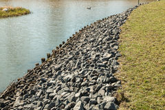 Bank of the river. With stones Royalty Free Stock Photo