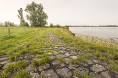 Bank of a river strengthens with basalt blocks Stock Photography