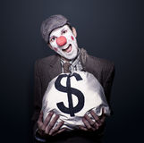 Bank Robber Clown Running With Bag Of Funny Money Royalty Free Stock Photography