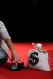 Bank robber with money sack surrenders Stock Photography