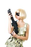 Bank robbery. Woman in dress made of dollars and mask with rifle Stock Photos