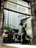 Bank robbery. Two armed bank robbers coming out of a bank, where an accomplice waits them with a car Royalty Free Stock Image