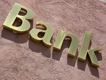 Bank Roll. Gold bank sign slanted, on a roll Royalty Free Stock Photo