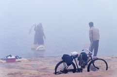 On the bank of the sacred river Ganges at cold foggy winter morning. Varanasi Stock Photography