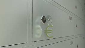 Bank safe deposit boxes and the key with euro sign keychain, CGI. Safe deposit boxes in a bank and the key with euro sign. Shallow focus Royalty Free Stock Photography