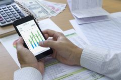 Bank Saving Deposit and Cash Flow Management. Analysing saving deposit bank account in cash flow statement management with mobile application stock photography