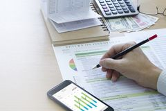 Bank Saving Deposit and Cash Flow Management. Businessman analysing saving deposit bank account in cash flow statement management with mobile application and stock image
