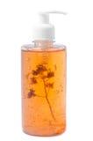 Bank of shampoo with orange flower cumin. Bank of shampoo with orange flower Royalty Free Stock Photo