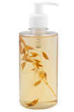 Bank of shampoo with a sprig of flax. Bank of shampoo with sikelet wheat stock photos