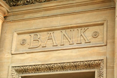 Bank sign. Above it's entrance in carved letters Royalty Free Stock Photo