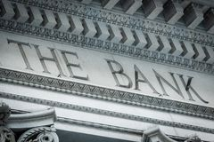 Bank Sign in a building classic facade. Bank Sign in a building classic vintage facade royalty free stock image