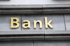 Bank Sign on Building Facade Stock Image
