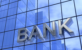 Bank sign on glass building. Exterior of modern blue glass building with bank sign royalty free stock photos