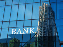 Free Bank Sign On Glass Blue Wall Royalty Free Stock Image - 92613876