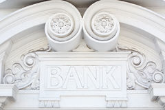Bank sign in stone on decorated facade Royalty Free Stock Photos
