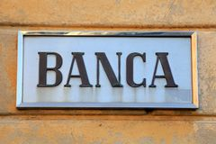 Bank sign, Italy. Bank sign on stone wall facade, Italy royalty free stock image