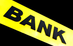 Bank Sign. The word bank written on a yellow diagonal stripe Stock Images