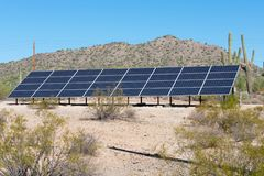 Solar panels on a hill side in the desert royalty free stock photography