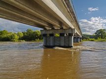 On bank of the spring river at bridge Stock Image