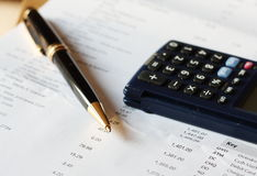 Bank statement. With a pen and calculator - shallow depth of field Royalty Free Stock Photography