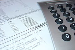Bank statement with calculator. Account checking Stock Photography