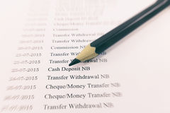 Bank statement paper with pencil on zoom effect. Royalty Free Stock Photos