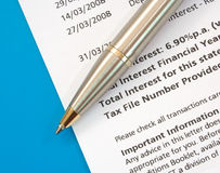 Bank Statement and pen. Working on finances with bank statement and pen Stock Photos