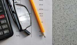 Bank statement with pencil glasses and calculator Stock Photos