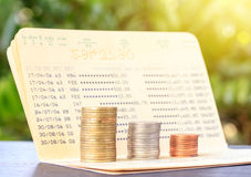 Bank statement with Stacks of coins Stock Image