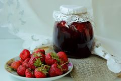 Bank with strawberry jam Royalty Free Stock Images